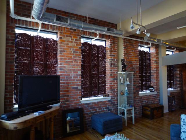 Interior thin brick veneer in Industrial style condo. industrial-family-room