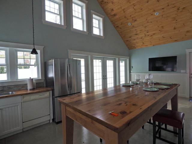 Small coastal open concept concrete floor family room photo in Boston with blue walls
