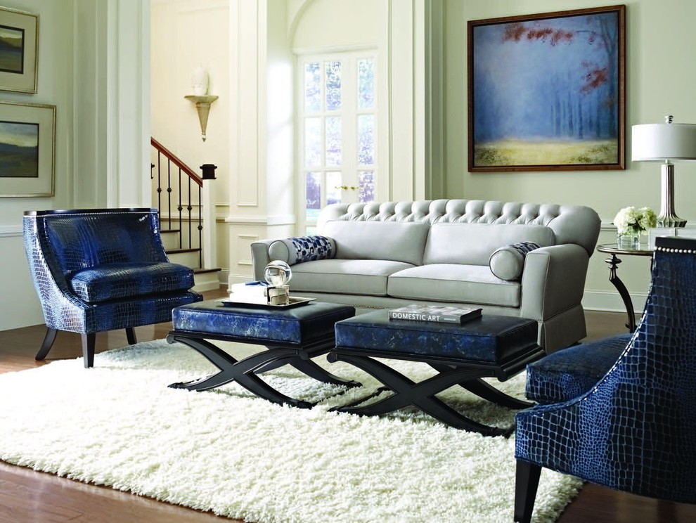 Example of a trendy dark wood floor family room design in Austin with beige walls