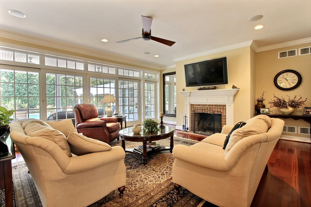 Inspiration for a timeless family room remodel in Baltimore with a brick fireplace