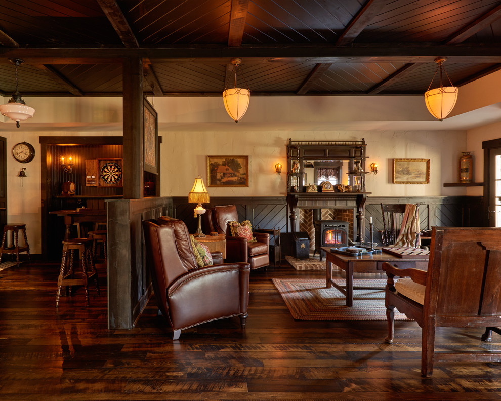 Inspiration for a mid-sized rustic dark wood floor family room remodel in Charlotte