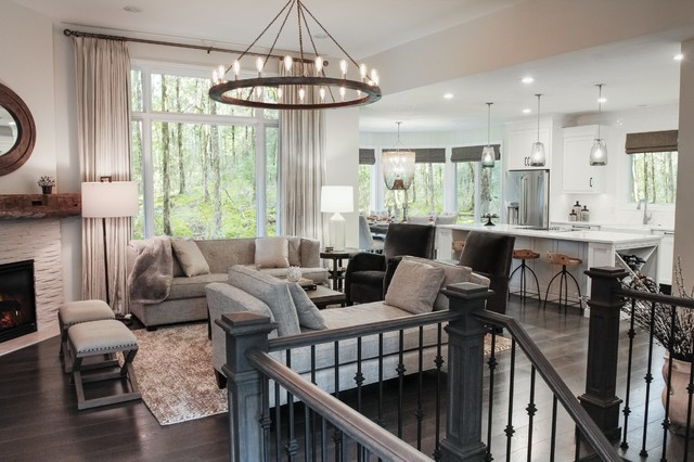 Mid-sized transitional open concept dark wood floor family room photo in Grand Rapids with gray walls, a corner fireplace, a stone fireplace and a tv stand