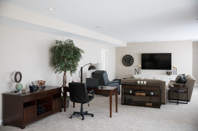 Inspiration for a mid-sized transitional open concept carpeted and beige floor family room remodel in Other with beige walls and a wall-mounted tv
