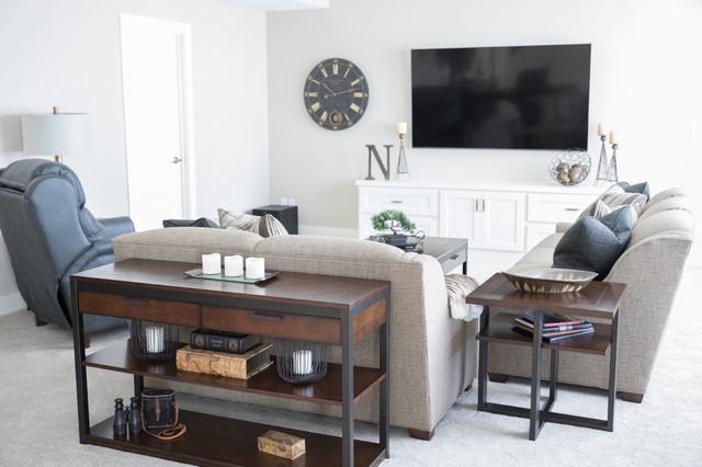 Mid-sized transitional open concept carpeted and beige floor family room photo in Other with beige walls and a wall-mounted tv