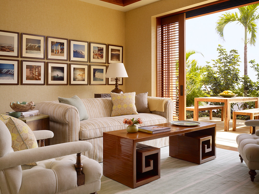 Family room - tropical family room idea in Hawaii with beige walls