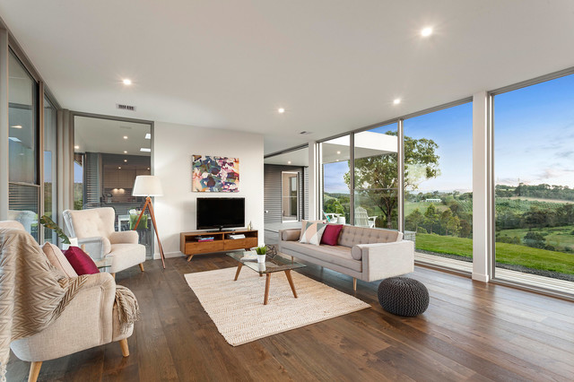 Trendy dark wood floor family room photo in Melbourne with white walls, no fireplace and a tv stand