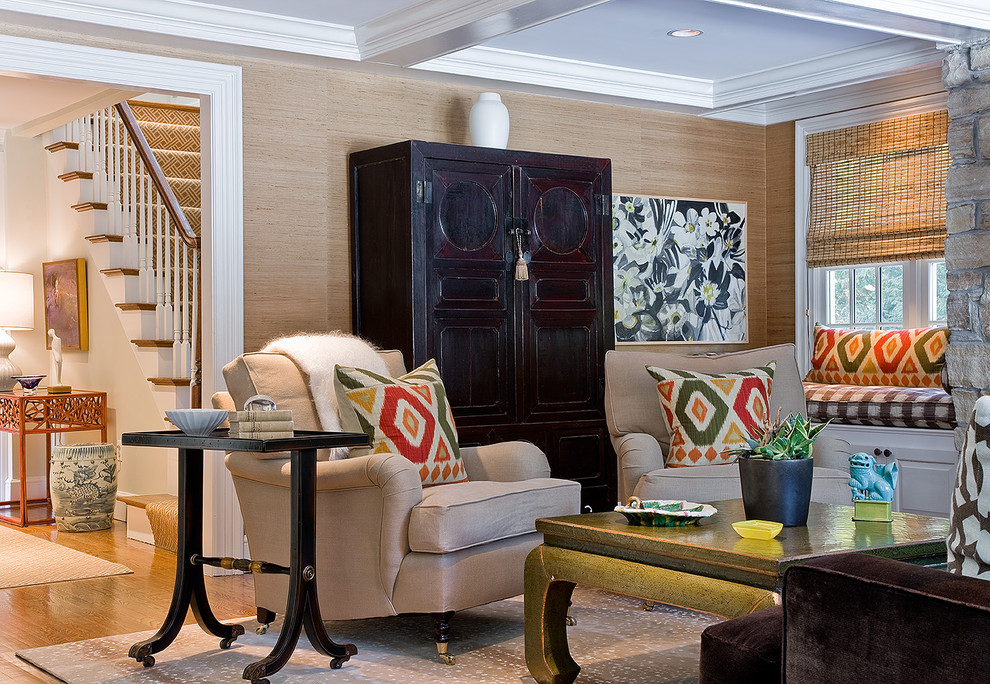 Example of a transitional medium tone wood floor family room design in Boston with beige walls