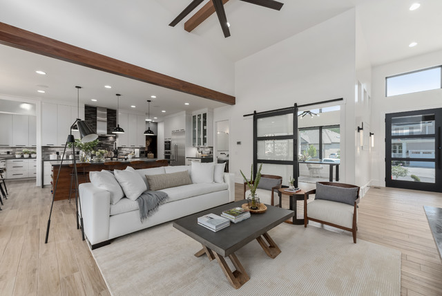Inspiration for a large contemporary open concept porcelain floor and beige floor family room remodel in Salt Lake City with white walls, a standard fireplace, a tile fireplace and a wall-mounted tv