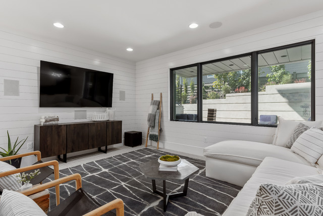 Inspiration for a large contemporary open concept carpeted and gray floor family room remodel in Salt Lake City with white walls and a wall-mounted tv