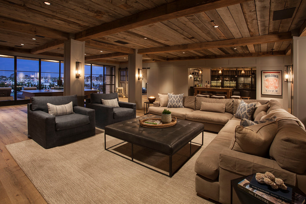 Beach style open concept medium tone wood floor and brown floor family room photo in Orange County with beige walls