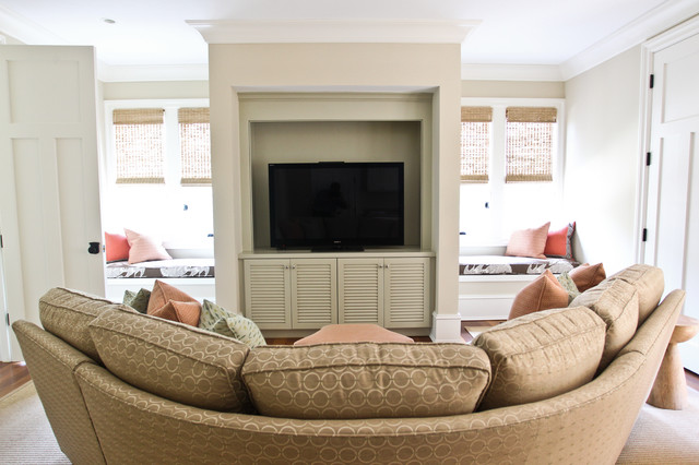 Family room - beach style family room idea in Charleston with beige walls and a media wall