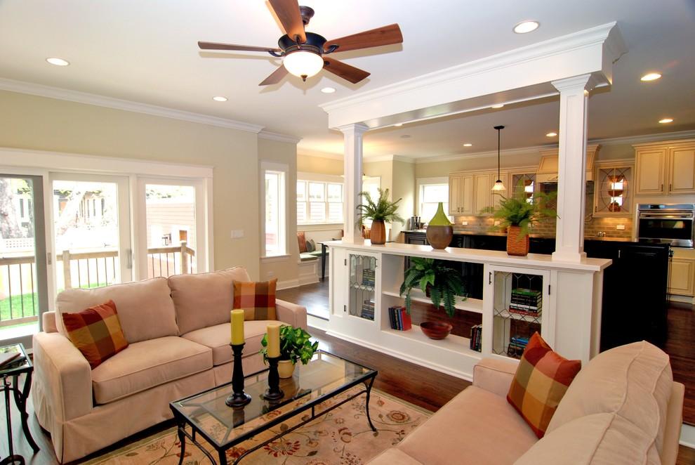 Elegant open concept dark wood floor family room photo in Chicago with beige walls