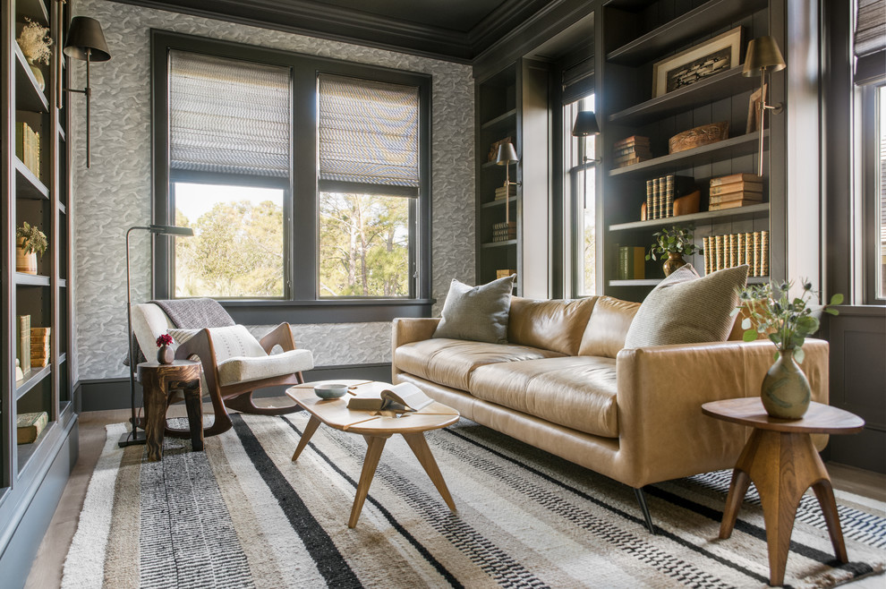 Inspiration for a coastal family room library remodel in Charleston with gray walls