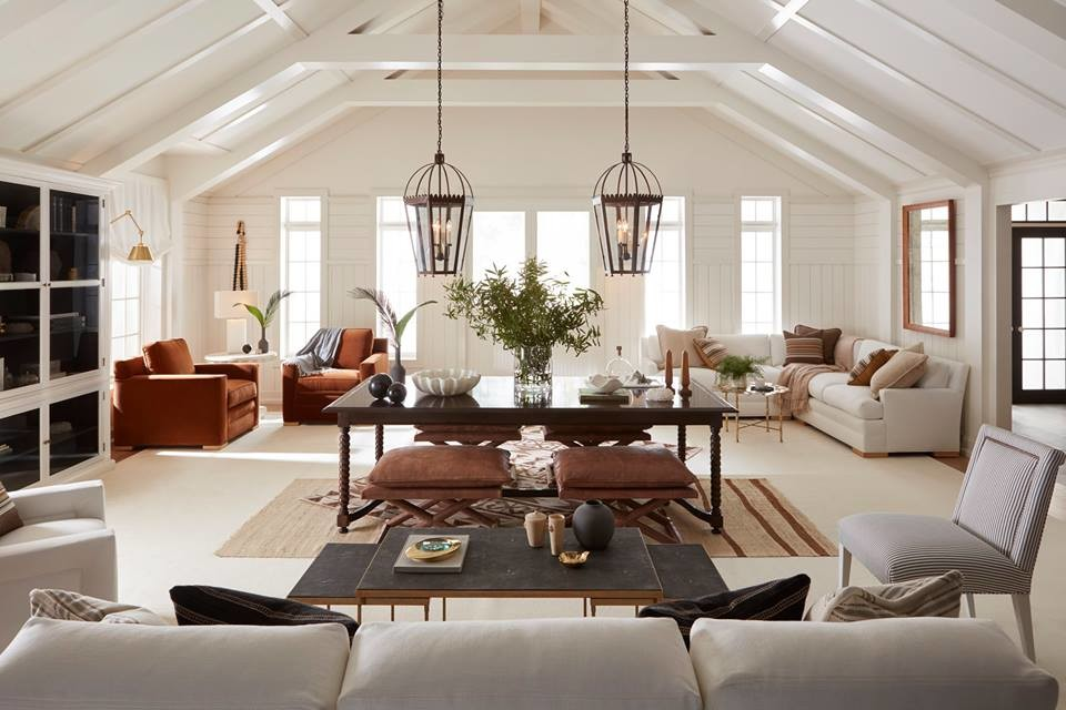 Example of a large country open concept medium tone wood floor and brown floor family room design in Portland with white walls and no fireplace