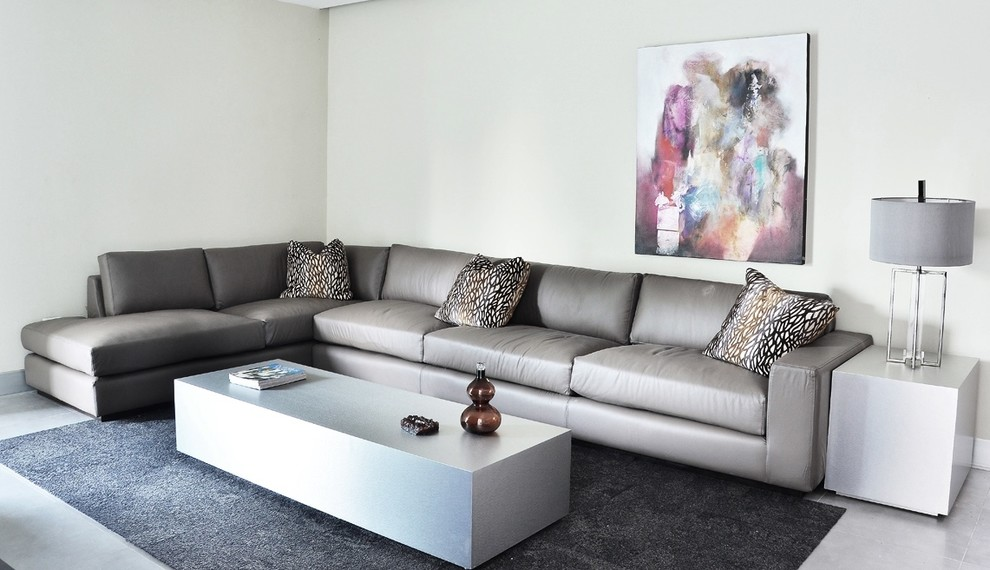 Example of a mid-sized minimalist enclosed ceramic tile family room design in Los Angeles with a wall-mounted tv