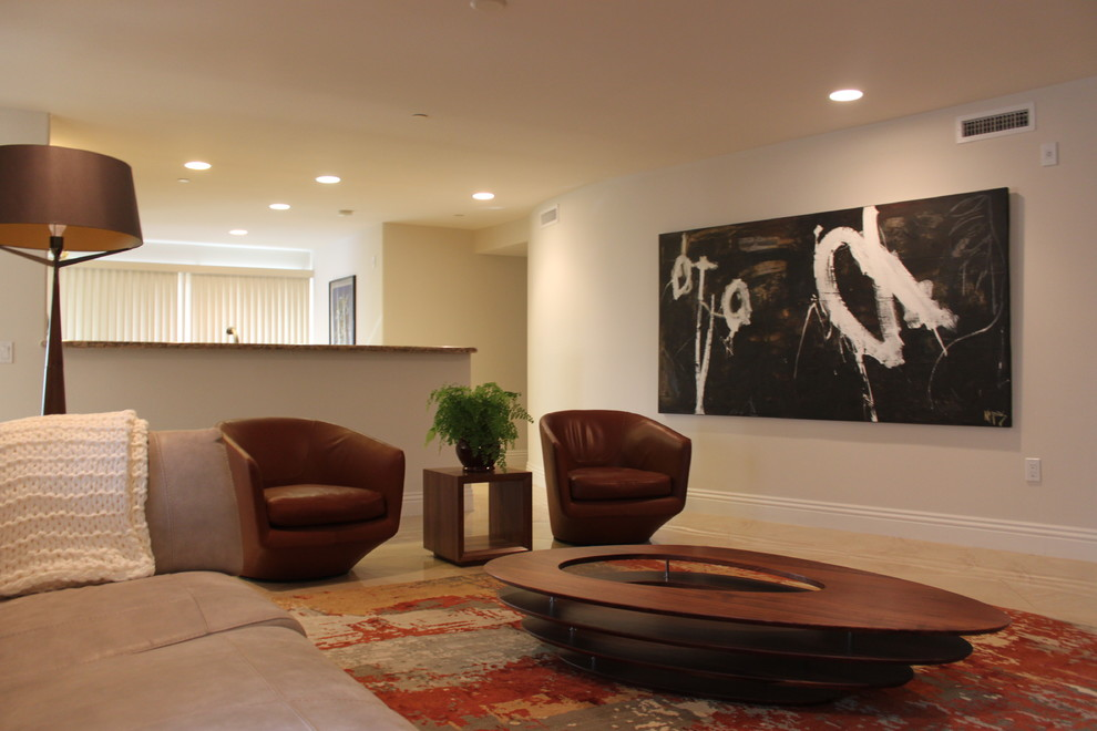 Inspiration for a small modern open concept limestone floor family room remodel in San Diego with white walls, no fireplace and a wall-mounted tv