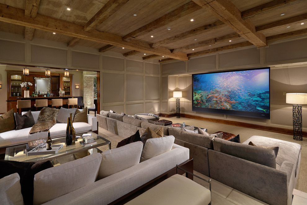 Family room - huge mediterranean enclosed family room idea in Orange County with beige walls and a wall-mounted tv