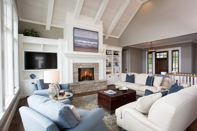 Mid-sized coastal open concept dark wood floor and brown floor family room photo in Other with beige walls, a standard fireplace, a stone fireplace and a wall-mounted tv
