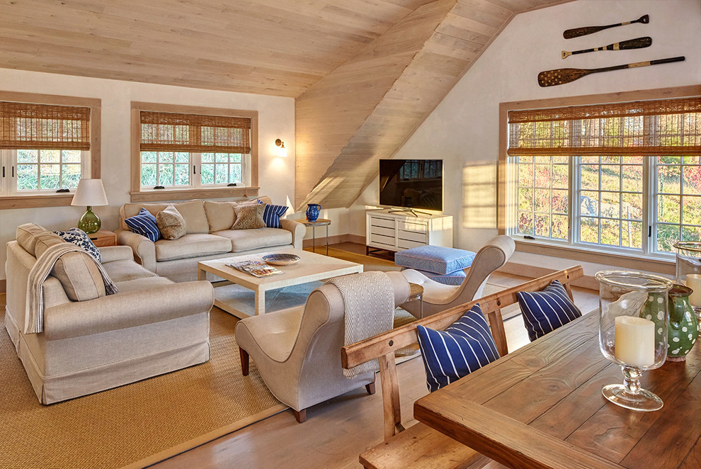 Example of a classic medium tone wood floor family room design in New York with white walls and a tv stand