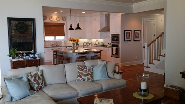 Coastal open concept light wood floor family room photo in Charlotte