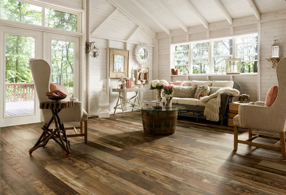 Inspiration for a mid-sized farmhouse open concept medium tone wood floor family room remodel in St Louis with white walls
