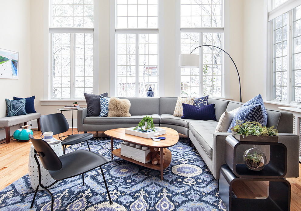 Inspiration for a large transitional medium tone wood floor family room remodel in New York with no fireplace, no tv and beige walls