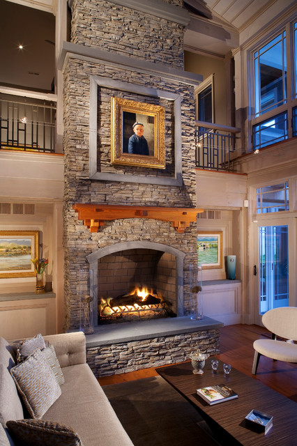 Large Stacked Stone Fireplace With Wood Mantle And Stone