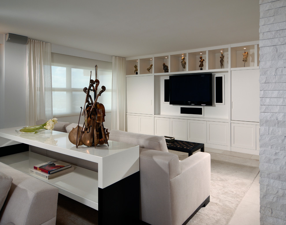 Example of a large trendy open concept carpeted and beige floor family room design in Miami with white walls, no fireplace and a media wall