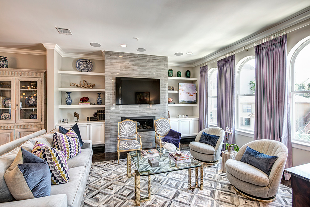 This is an example of a large eclectic open concept family room in Houston with grey walls, dark hardwood floors, a standard fireplace and a stone fireplace surround.