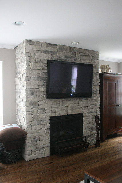 Beautiful white/grey custom colored ledge stone dry stack stone fireplace with flat screen television installed