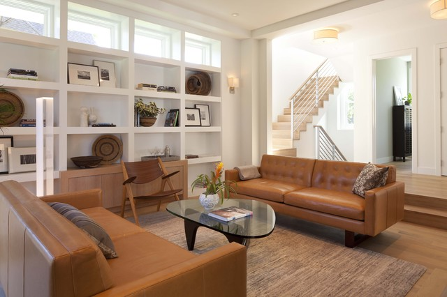 Inspiration for a modern medium tone wood floor family room remodel in  Minneapolis with white walls