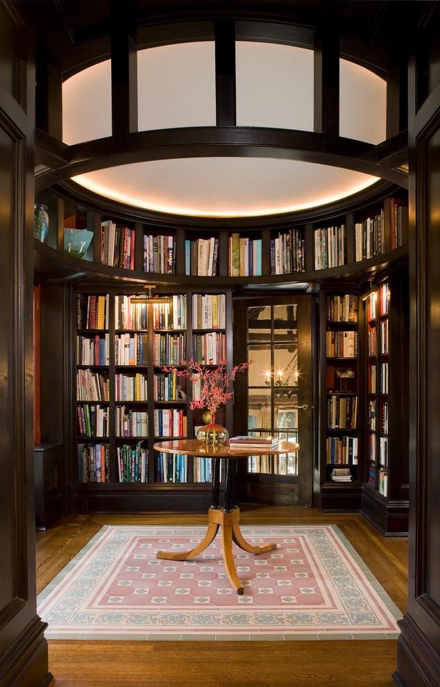Large elegant enclosed dark wood floor and brown floor family room library photo in New York