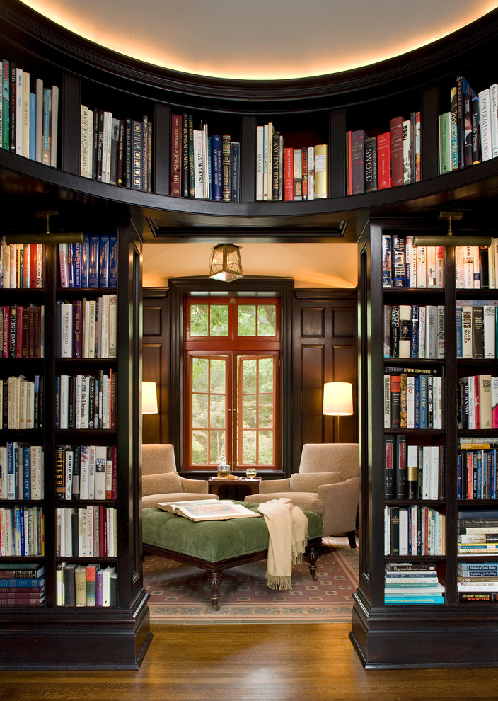 Inspiration for a large timeless enclosed dark wood floor and brown floor family room library remodel in New York with brown walls