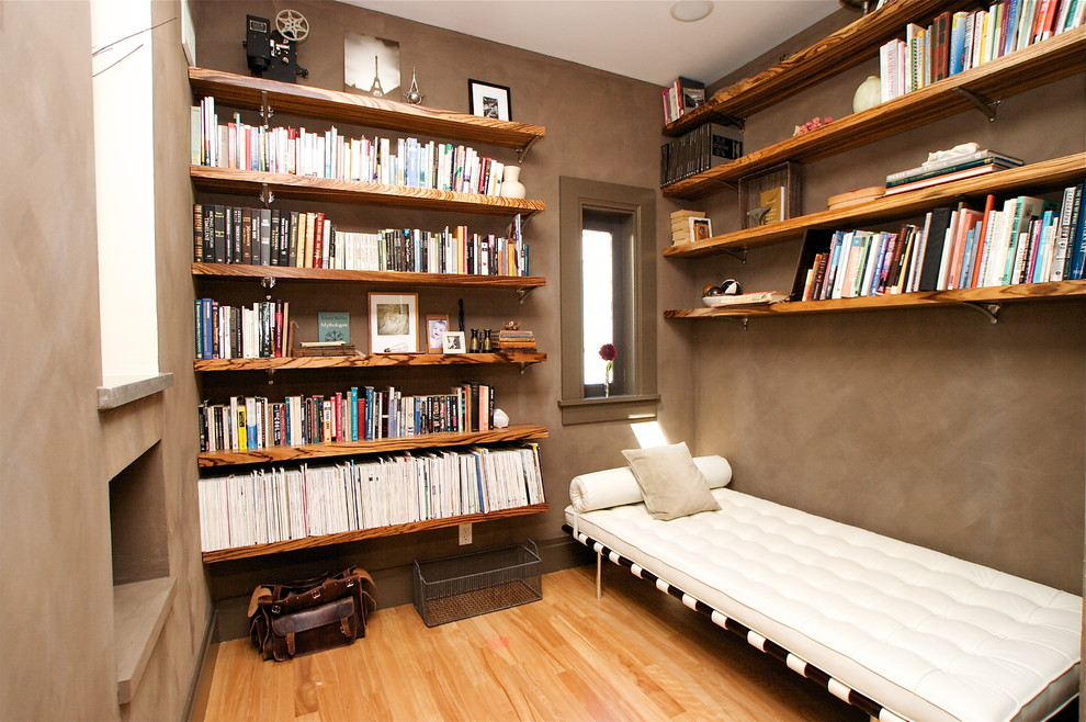 Example of a trendy family room library design in San Francisco