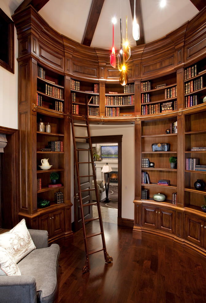 Large elegant enclosed dark wood floor and brown floor family room library photo in Salt Lake City with white walls, no fireplace and no tv