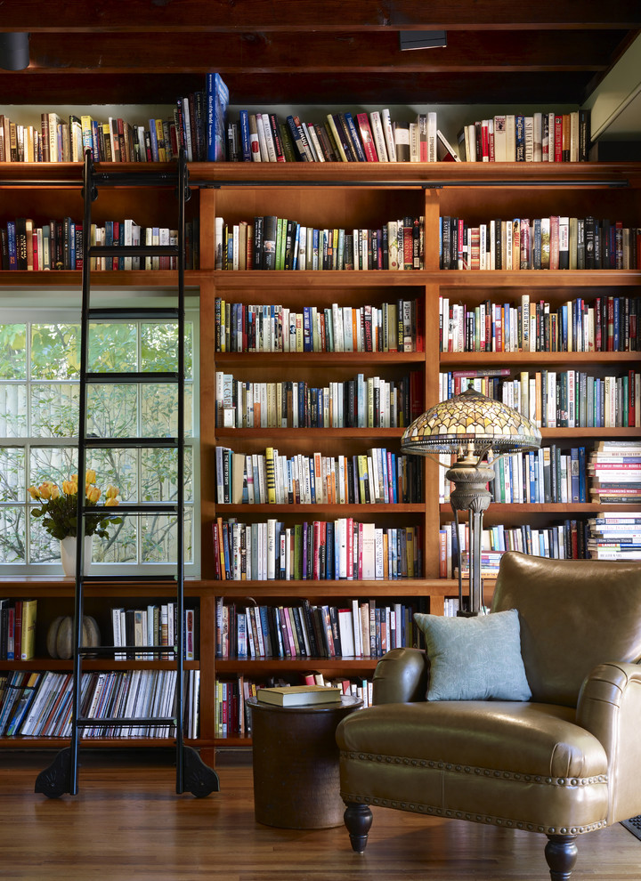 Inspiration for a craftsman medium tone wood floor family room library remodel in Philadelphia