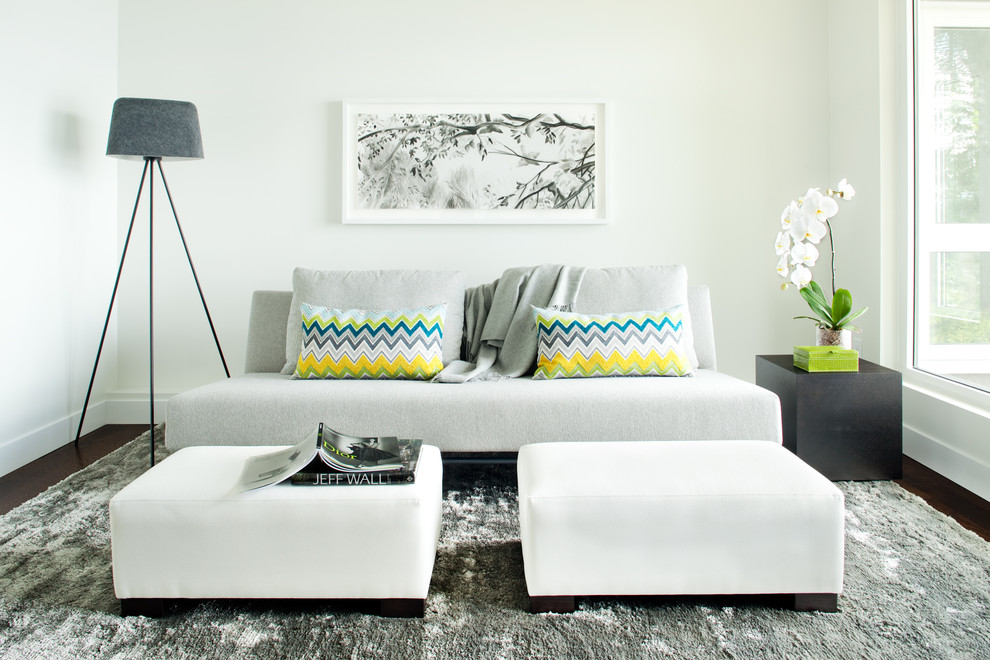 Example of a trendy brown floor family room design in Vancouver with white walls