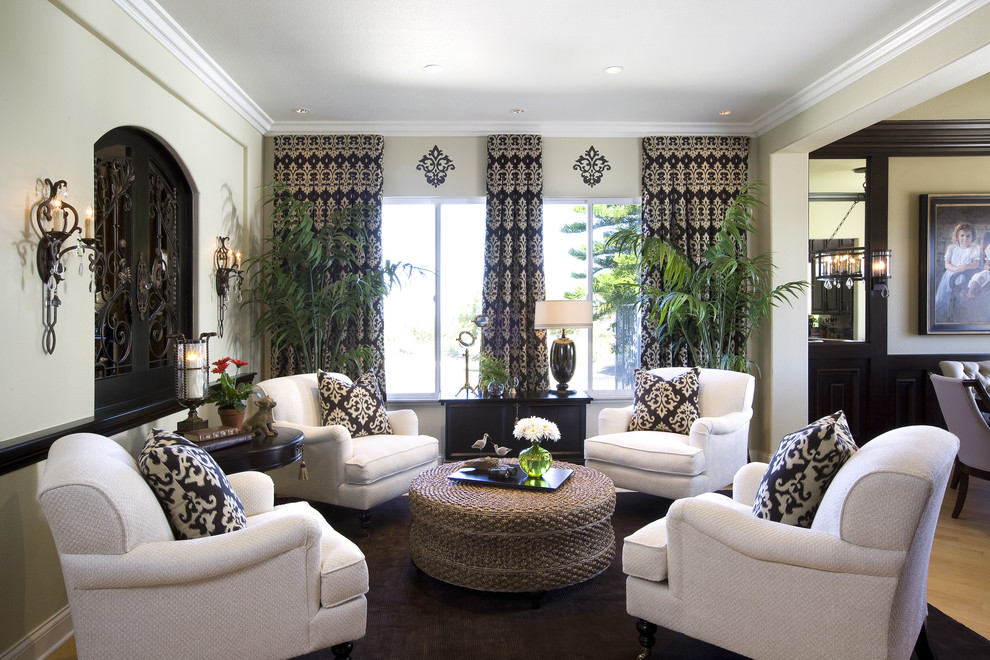 Elegant family room photo in San Diego with beige walls