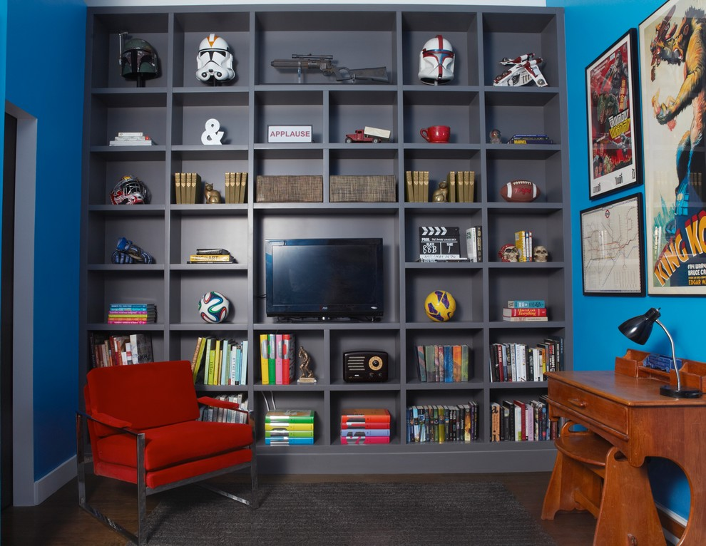Family room library - mid-sized contemporary loft-style dark wood floor family room library idea in New York with blue walls and a media wall