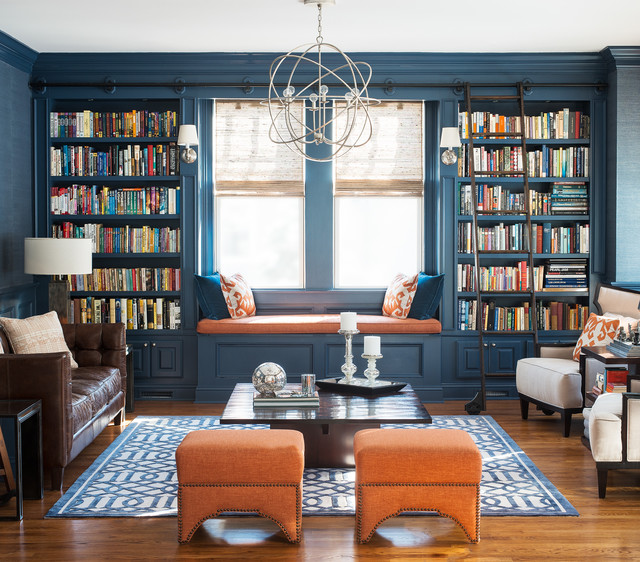 Example of a transitional medium tone wood floor family room design in New York with blue walls