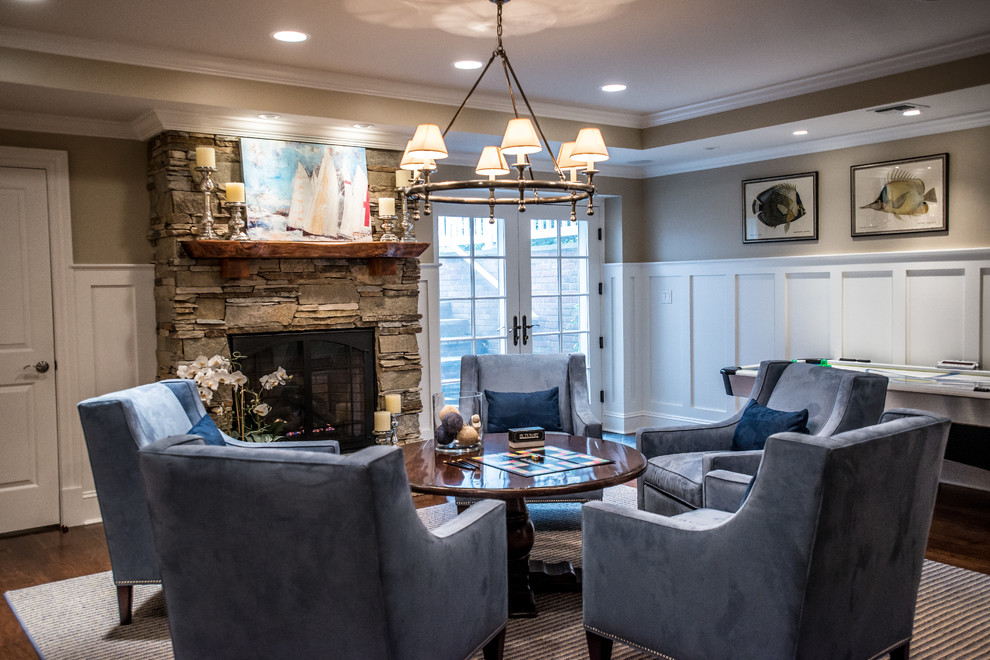 Inspiration for a timeless family room remodel in New York with a standard fireplace and a stone fireplace