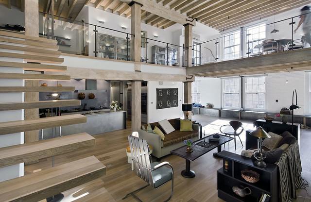 Loft renovation industrial family room new york by for Loft floor construction