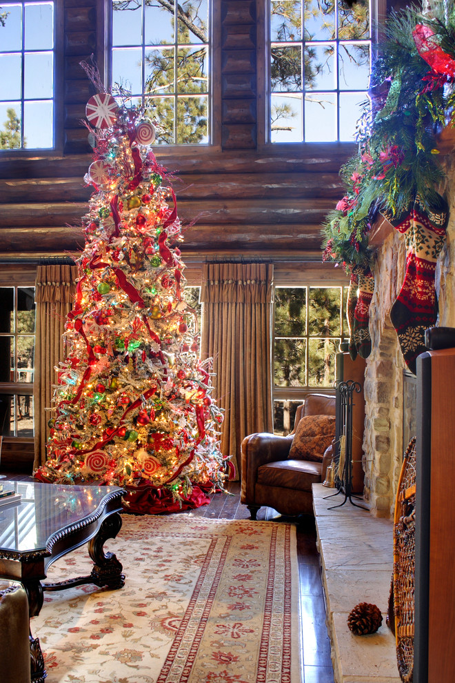 Inspiration for a rustic family room remodel in Los Angeles with a stone fireplace