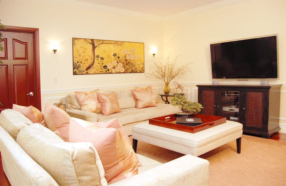 Elegant family room photo in New York with beige walls and a wall-mounted tv