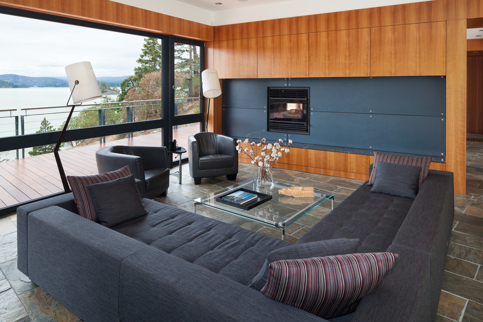 Example of a large trendy open concept slate floor family room design in Vancouver with brown walls, a standard fireplace and a metal fireplace