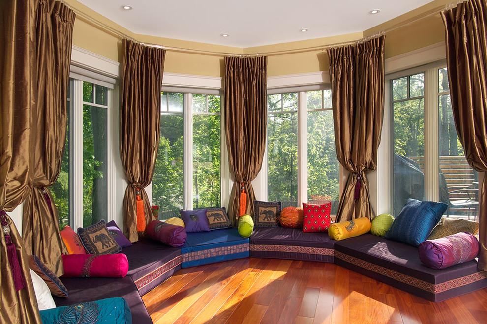 Family room - huge zen open concept medium tone wood floor and orange floor family room idea in Toronto with beige walls