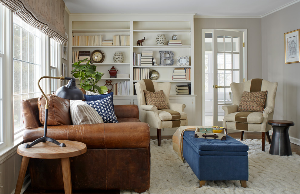 Family room - traditional enclosed dark wood floor family room idea in New York with gray walls