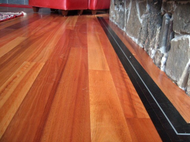 Awesome Lyptus Hardwood Flooring Part - 1: Lyptus Flooring With Wenge Feature Strip And Aluminum Inlay  Modern-family-room