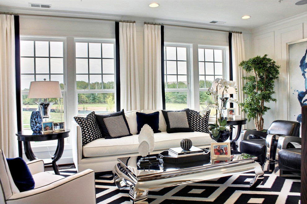 Example of a trendy family room design in DC Metro with beige walls