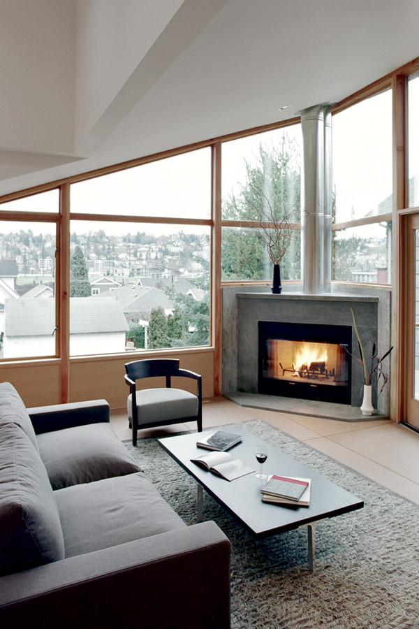 Minimalist family room photo in Seattle with a corner fireplace